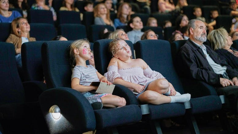 two children in a theatre audience
